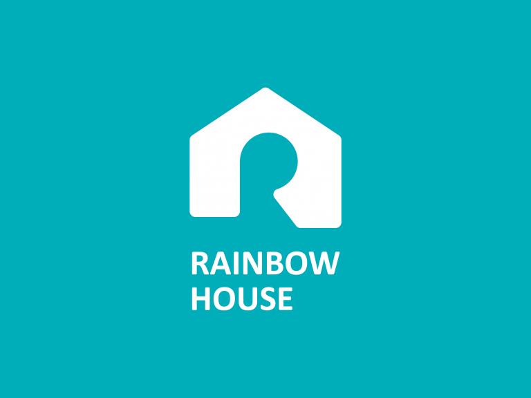 藍綠色的底色有白色的房子在上頭